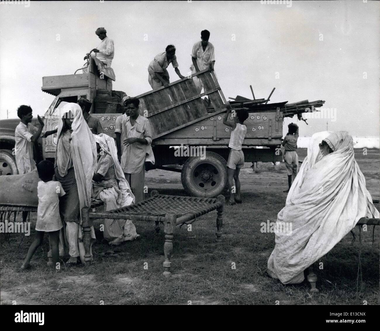 Mar. 02, 2012 - Destination reached: Pakistani families unload their simple crude furniture on arrival at the new - Stock Image