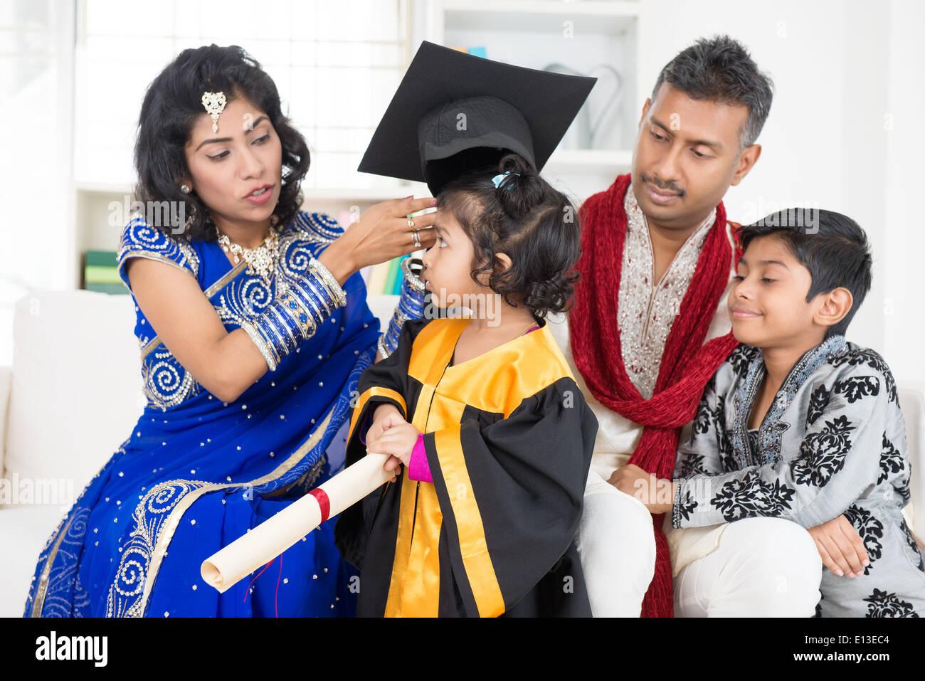 Kindergarten Graduation Asian Indian Family Parents And Children On Kinder Graduate Day