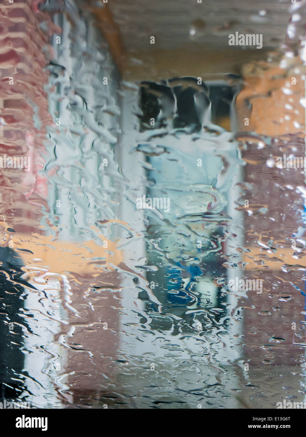 Water drops on transparent glass from rain - Stock Image