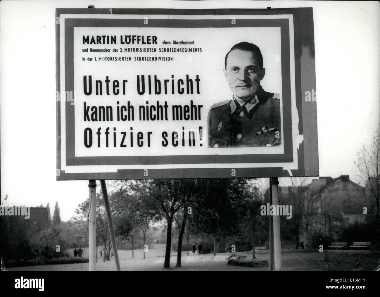 Mar. 02, 2012 - Well visible for the Eastberlin people police and Eastgerman Volksarme and all Eastberlin people, the Westberlin police put up this placard all along the wall and the sector border. The placards shows the escaped Eastgerman Volksarmee officer, Lt. Col. Martin Loffler and the words: I can not more be officer under command of Ulbricht. Keystone Berlin, 30.10.62 - Stock Image