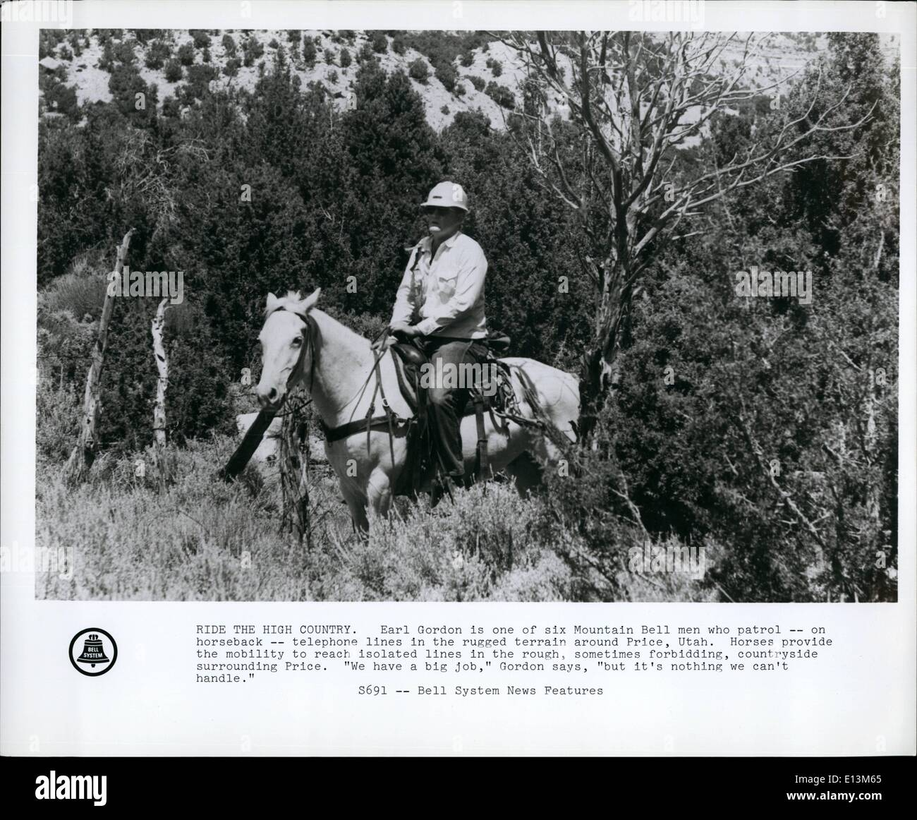 Mar. 22, 2012 - Ride the High Country. Earl Gordon is one of six Mountain Bell men who patrol on horseback , telephone - Stock Image