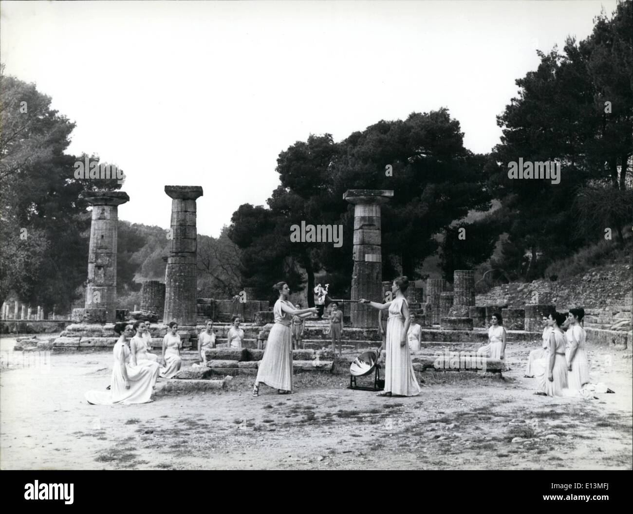 Mar. 22, 2012 - The Olympic Flame from the site of the first Olympic Games in ancient Olympia is handed over to the first relay - Stock Image