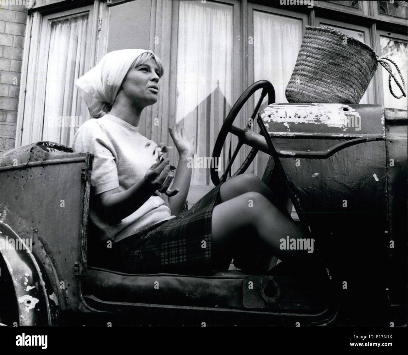 Mar. 02, 2012 - Julie Christie, has no transport of her own... but her landlady's mechanic son Paul Cetti has a Wolseley Hornet, and Julie tries it out for size. - Stock Image