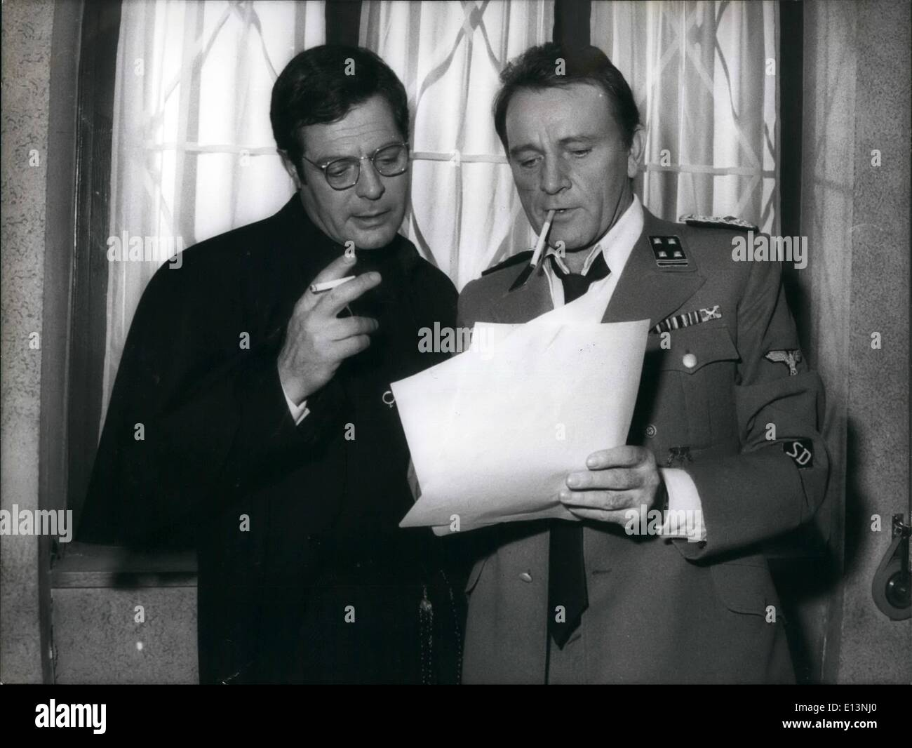 Mar. 22, 2012 - British actor Richard Burton and Marcello Mastroianni are turning the film ''Death in Rome'' draft by the Robert Katz's book that concerns the attempt of Via Rasella in Rome where 33 German soldiers were killed and 335 hostages were shot at the Fosse Ardeatine, near the town. Burton plays the role of the SS colonel Manfred Kappler who ordered the reprisal and Marcello Mastroianni plays the role of a partisan priest Don Pietro. The film is directed by Yorgo Pan Cosmatos (with moustaches in some photos) - Stock Image