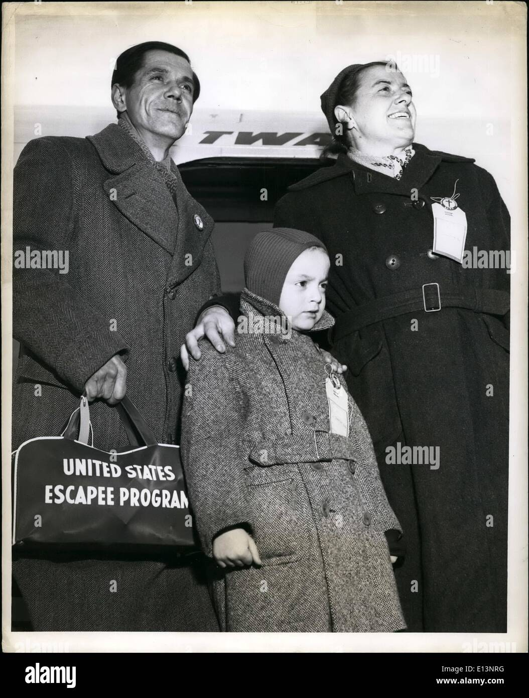Mar. 22, 2012 - Mc Quine Air Force Sase, N.J.: Their first look at America and new found freedom is taken by this family of Hungarian refugees as they step out the TWA international constellation that flew them here today from Munich, Germany. Mother Ilona and Father Liendor stand behind their six and a half year son Csaba. They were among 120 refugee flown today by TWA. - Stock Image