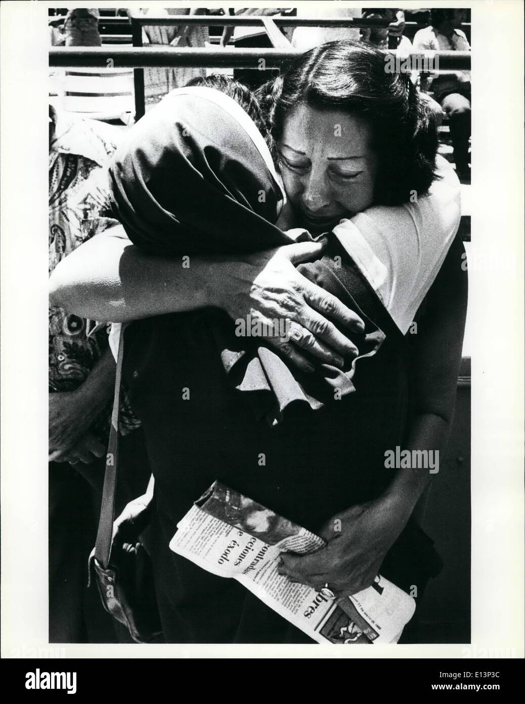 Mar. 22, 2012 - A Cuban refugee woman gives a tearful hug to a nun after the sisters had helped deliver the first mass to the refugees since they arrived in the U.S. the mass was performed in the Orange Bown in Kiami. The orange bowl was used as a holding area for the refugees before they were moved to processing centers in the Miami - Stock Image