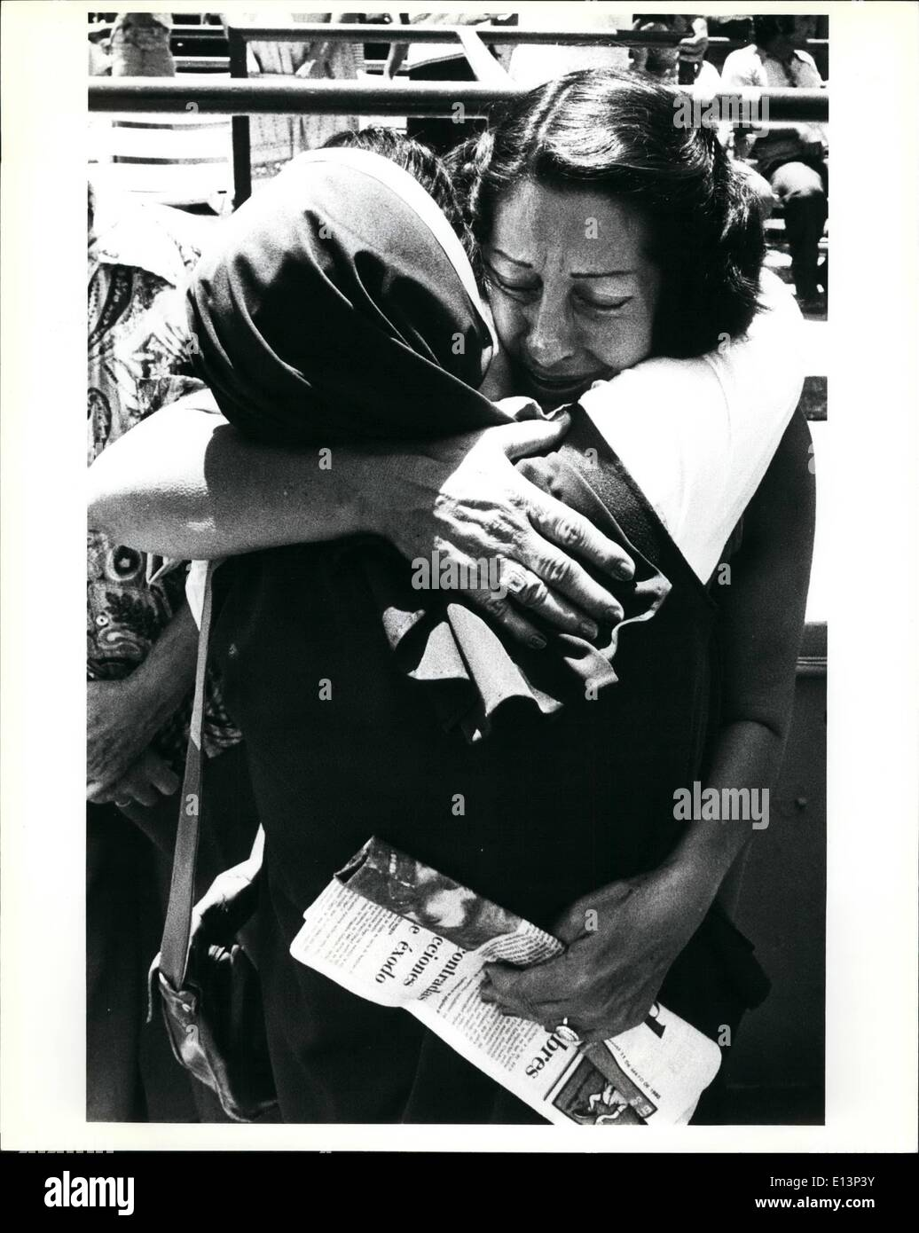 Mar. 22, 2012 - A Cuban refugee woman gives a tearful hug to a nun after the sister had helped deliver the first mass to the refugees since they arrived in the U.S. The mass was performed in the Orange Bowl in Miami. The Orange Bowl was used as a holding area for the refugees before they were move to processing centers in the Miami area. - Stock Image