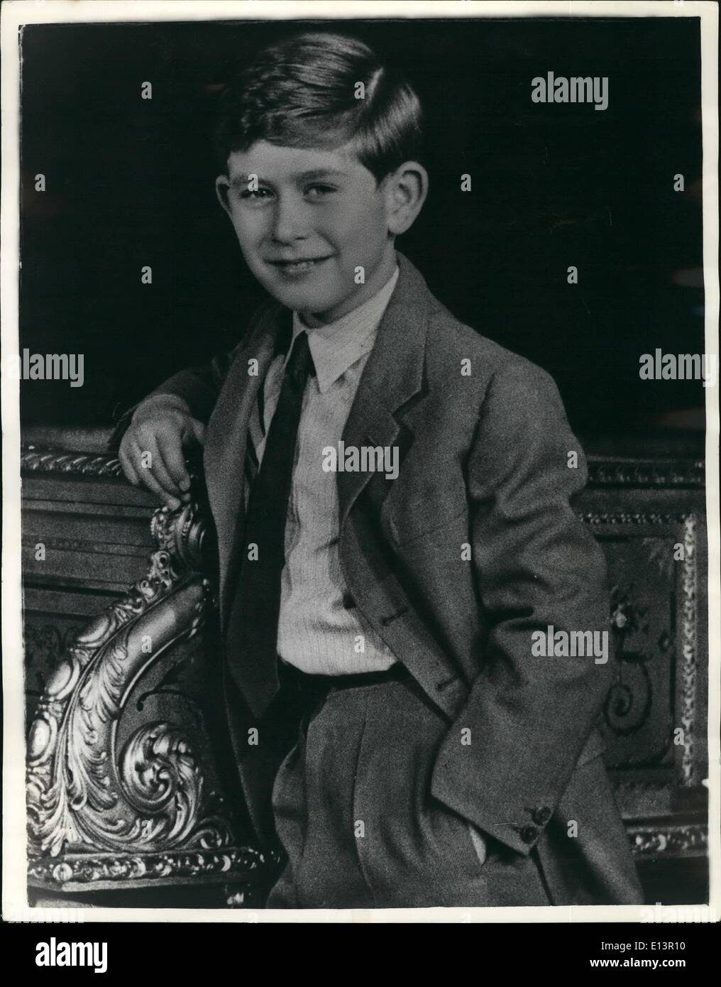 Mar. 22, 2012 - Ninth Birthday of H.R.H. Prince Charles, Duke of Cornwall.: The Prince's ninth birthday is celebrated on the 14th/ November 1957. This pictures was taken in one of the drawing room of Buckingham Palace; Prince Charles is leaning against a grand piano. His Royal Highness is wearing a grey suit with a red tie. Portrait study by Anthony Armstrong Jones; pleas acknowledge. - Stock Image