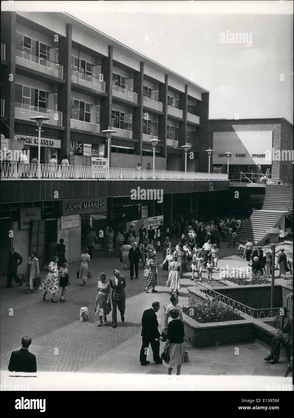 Mar. 22, 2012 - Residents and visitors enjoy the amenities of the Precincts shopping area at Coventry. In foreground in the picture are Jack albert and iceley Courteidge taking their poodle for an airing. - Stock Image
