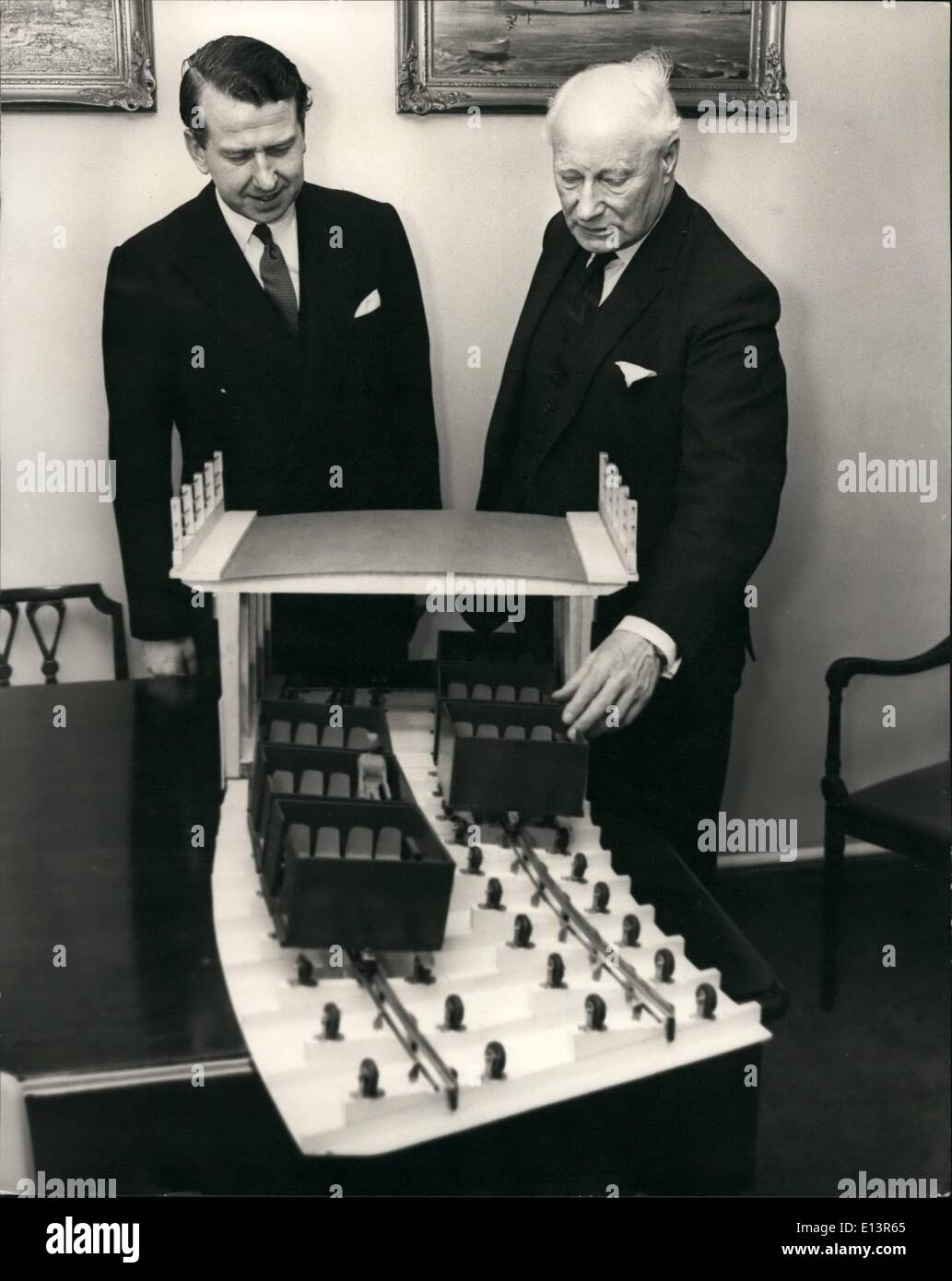 Mar. 22, 2012 - Complete Loop of I.A.A.S. Traffic report ''Overhead system'' to be built in London. Shadow Minister of Transport sees model of ''Passenveyor''. Mr. C.W. Glover, P.P.I.A.A.S., Mi.O.E., Struct.E., a past president of the Association and pioneer of the Passenveyor described in the 2nd. Traffic Report published by the Incorporated Association of Architects disclosed that negotiations are taking place between the Passenveyor or Company and authorities concerned for a site near Staines to set up a complete loop for interested parties from all over the world to ride in and full - Stock Image