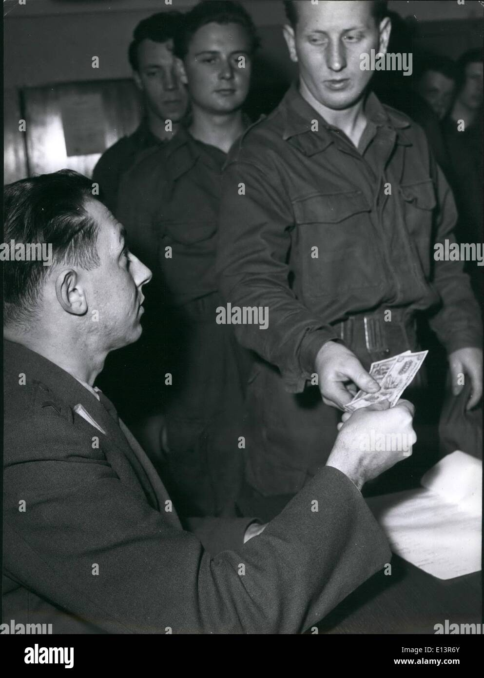 Mar. 22, 2012 - Germany's first post war draftees: A very important day pay-day. Each draftee receives twice a month German Marks 30.00 (approx. 7.50). Hard-earned money. - Stock Image