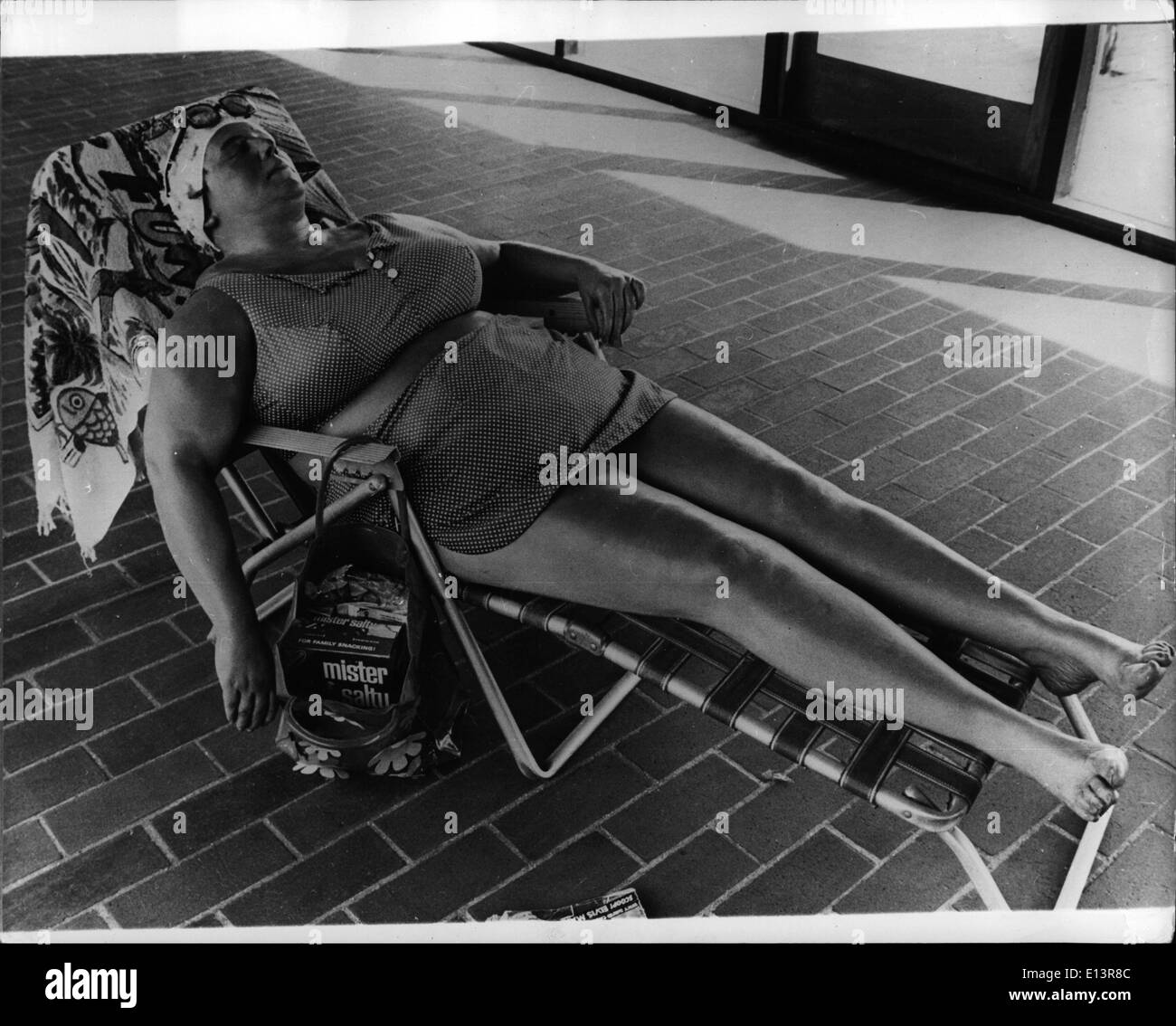 Mar. 27, 2012 - A Realistic Exhibit. : American sculptor, Duane Hanson, is holding an exhibition at the Louisiana Museum in Humlebak, Denmark, in which the figures, made in special forms of several materials, look like people from real life. Photo Shows An amazingly life-like figure of outsize woman relaxing in a sun-chair one of the exhibits on exhibition. - Stock Image