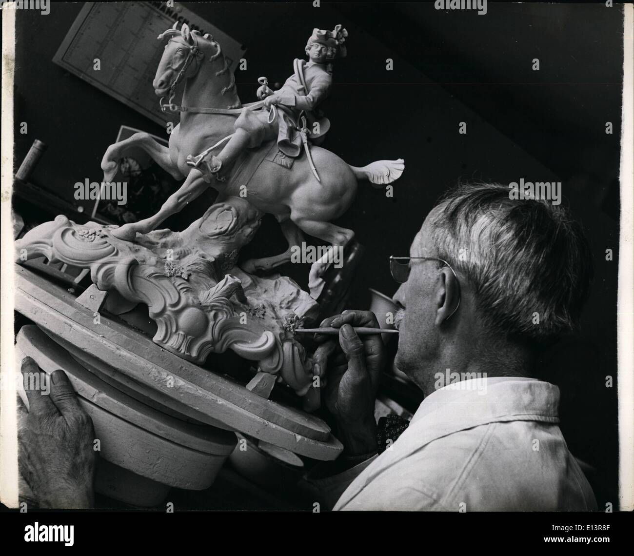 Mar. 27, 2012 - Dainty Dresden China from Russian Zone. Otto Zolliner, aged 61, craftsman at the factory for 36 years, working on the exquisite figure of a mounted cavalier. - Stock Image