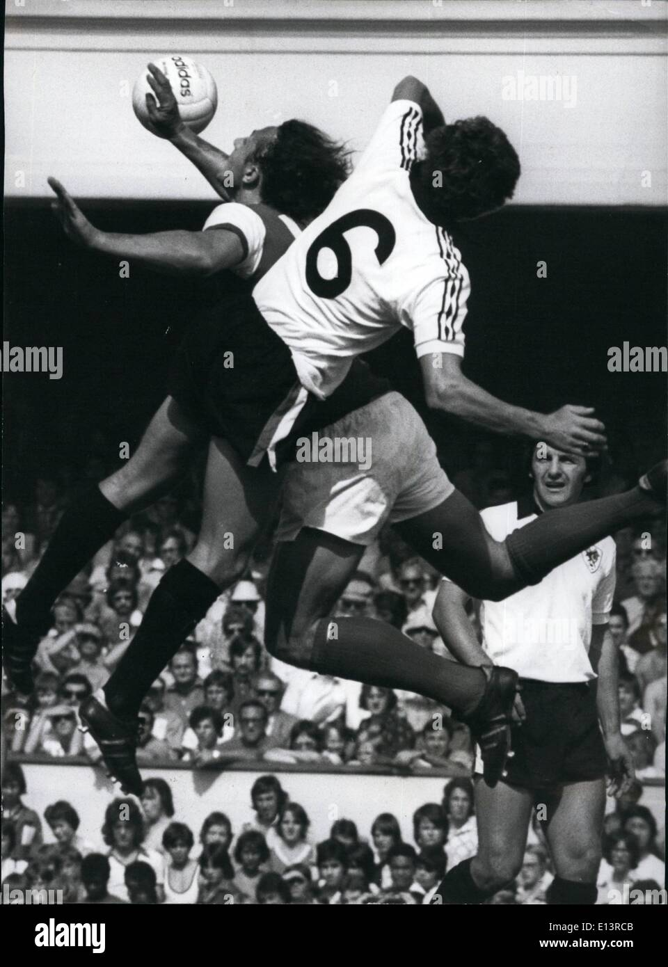 Mar. 27, 2012 - Reaching for it Gracefully: Geoff Kerrick of Bristol City does a ballet-style leap for the ball at the same time as Arsenal's John Radford, during a match at Highbury. - Stock Image