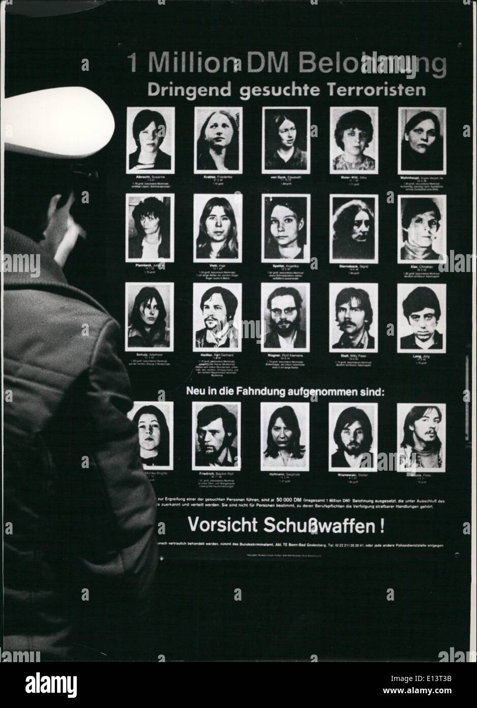 Mar. 27, 2012 - New Posters with Terrorists in the FRG: The criminal investigation department of the Federal Republic of Germany searches with a new poster for 20 countries. Photo shows a policeman sticks up the poster with the wanted terrorists. First row: Susanne Albrecht, Friderike Krabbe, Elisabeth Von Dyck, Silke Maierwitt, Brigitte Mohnhaupt (f.l.t.r - Stock Image