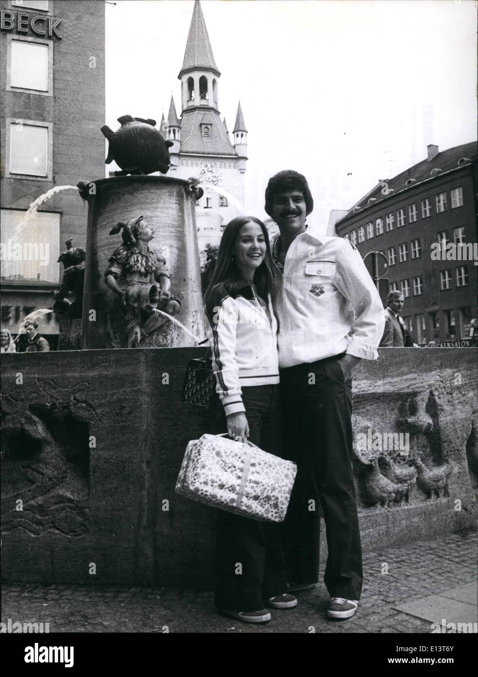Mar. 27, 2012 - Mark Spitz In The Federal Republic Of Germany 7 gold medals... Mark Spitz got in Munich 1972 at the Olymic Games, - now he came back to the town of his triumphs. With his wife Susan he visited remarkable places in Munich and he trainined with students in the Olympic Swimming Hall. And before he travelled to an other German town, his fondest with also came true. He got the starting -block on which he in 1972 celebrated his greatest achievements, and which he now brings to his home California. Photo Shows:- Mark Spitz and his wife Sus visit in Munich. - Stock Image