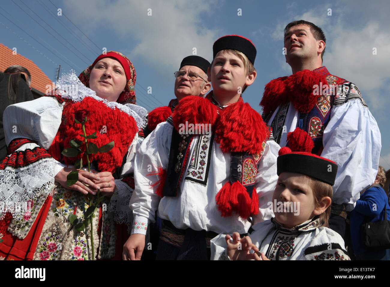 The Ride of the Kings. Traditional folklore festival in Vlcnov, Czech Republic. The boy king with his family. Stock Photo