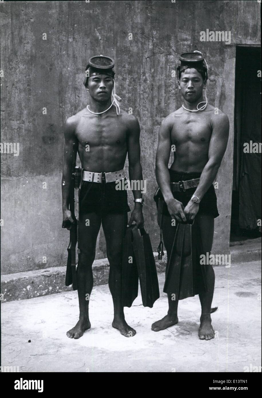 Mar. 27, 2012 - Two typical Chinese Nationalist Frogmen with their assault equipment, carbines, daggers, and pistols. Note the waterproof chronometers for syncronizing the time of their operations. - Stock Image