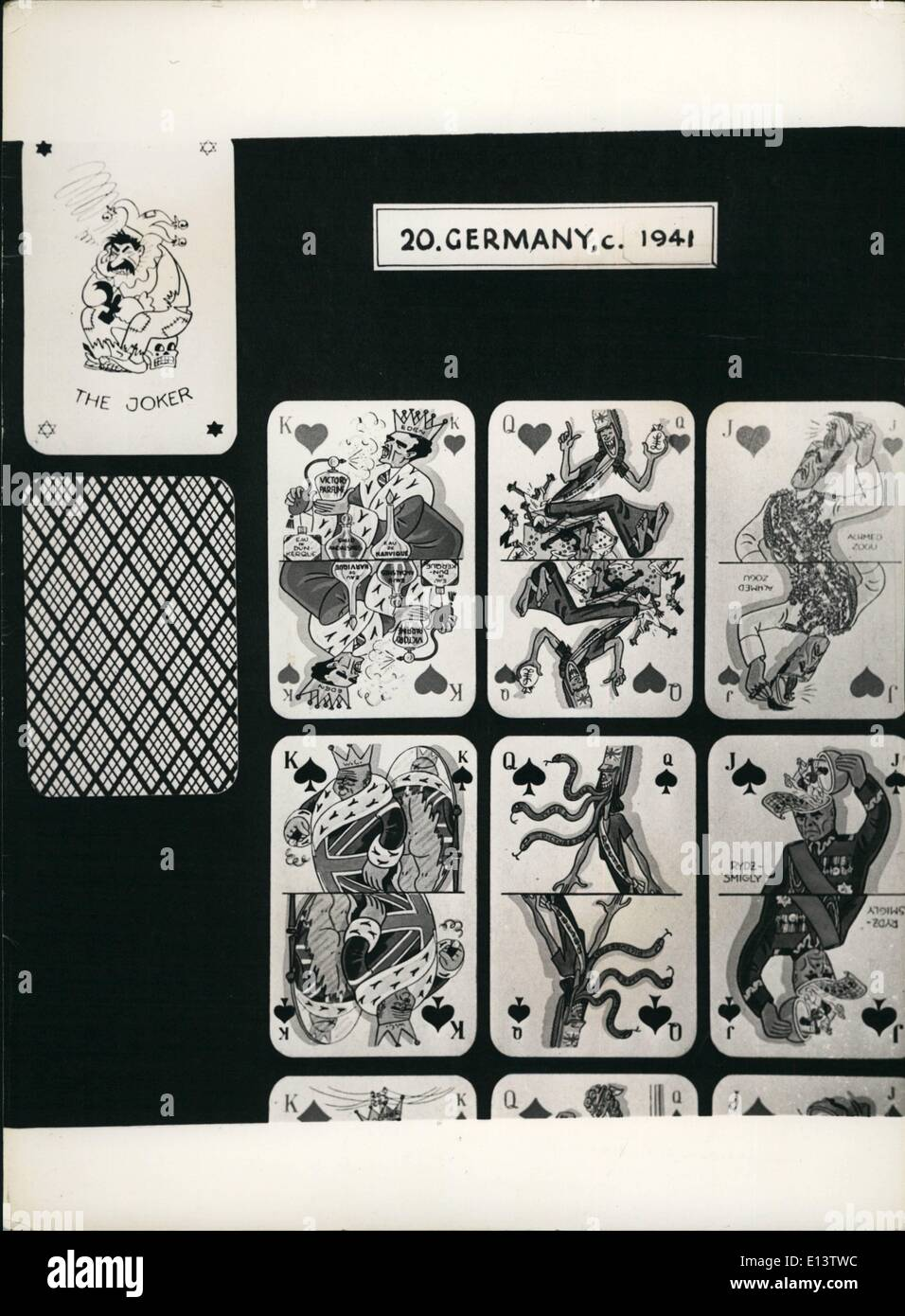 Mar. 27, 2012 - A German wartime propaganda set of playing cards Made to the order of Hitler after his attack on Russia (note Stalin as the Joker), The king of hearts is Mr. Eden perfuming himself with '' Victory perfume'' and ''Eau De Dunkirk' and Eau De Narvik''. The queen of Hearts is Britannia sacrificing the coloured subject races for her love of gold. The king of Spades is Mr. Churchill plummimg himself in union Jack Clothes shown in the mirror to be very tattered - Stock Image