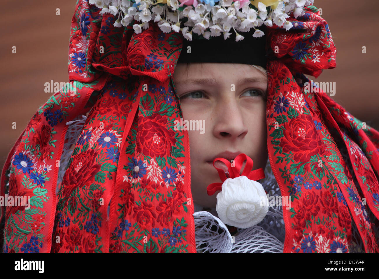 The Ride of the Kings. Traditional folklore festival in Vlcnov, Czech Republic. The boy king white rose in his mouth. Stock Photo