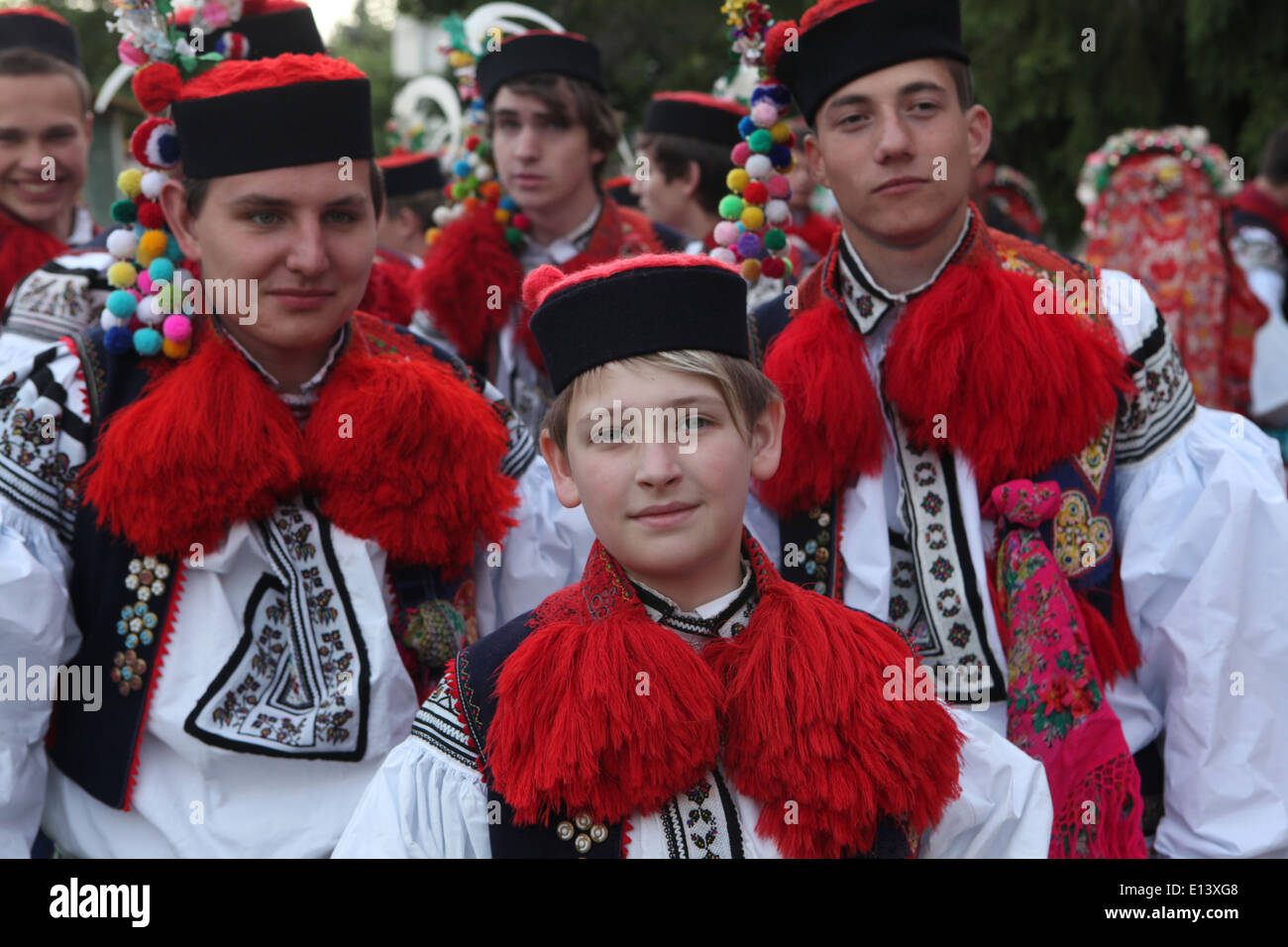 The Ride of the Kings. Traditional folklore festival in Vlcnov, Czech Republic. The boy king followed by the pageboys. - Stock Image