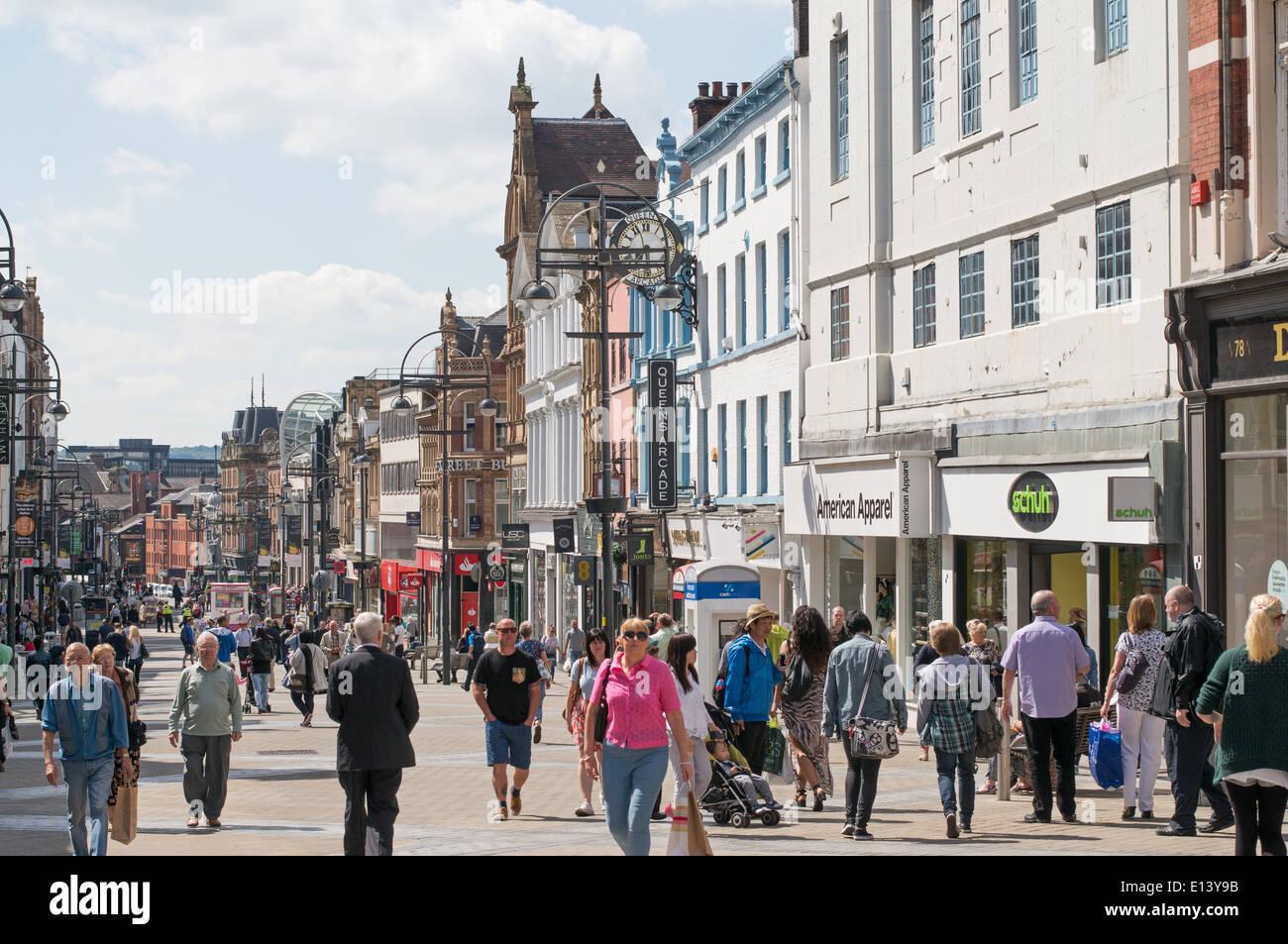 People shopping in Briggate, Leeds city centre, England UK - Stock Image
