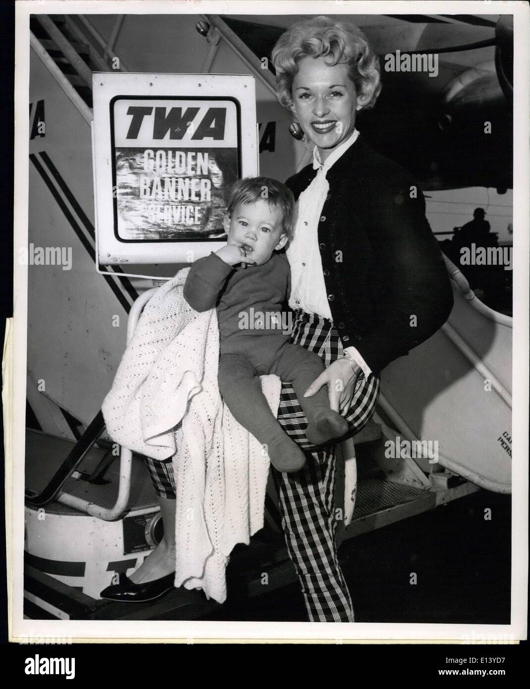 Mar. 31, 2012 - Idlewild Airport, N.Y. June 5: ''Mommy, I'm Not dressed'', exclaims little Melanie Griffith 9 months, after arriving aboard a TWA Super-G Constellation from Los Angeles. The embarrassed Miss and the her mother Mrs. Peter Griffith, better known in modeling circles as Tippi Hedren, were returning from TWO-week visit with Melanie's grandparents. - Stock Image