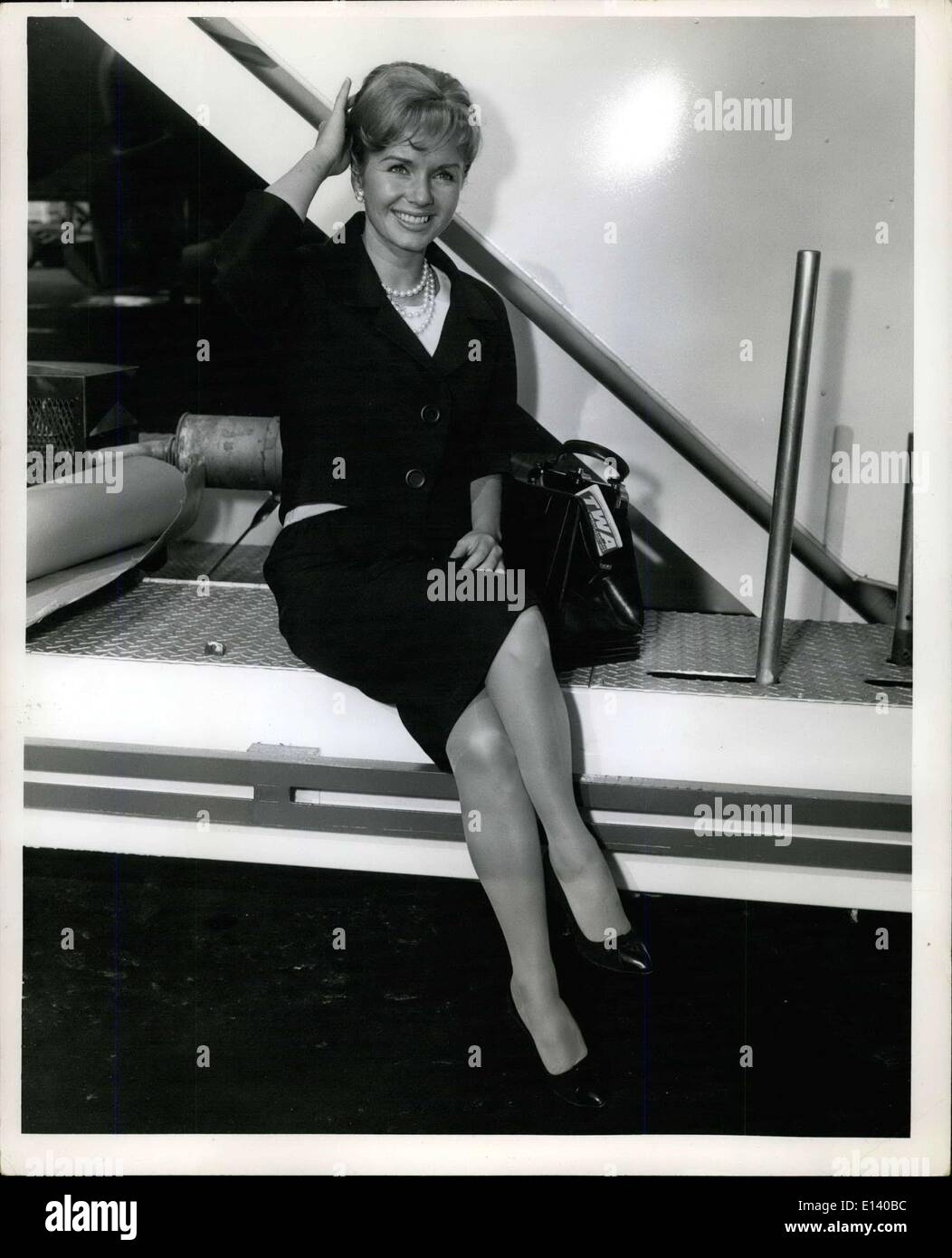 Mar. 31, 2012 - N.Y. International Airport, May 27, 1968: Pert Debbie Reynolds fixes her hair on arrival here via TWA superjet. - Stock Image