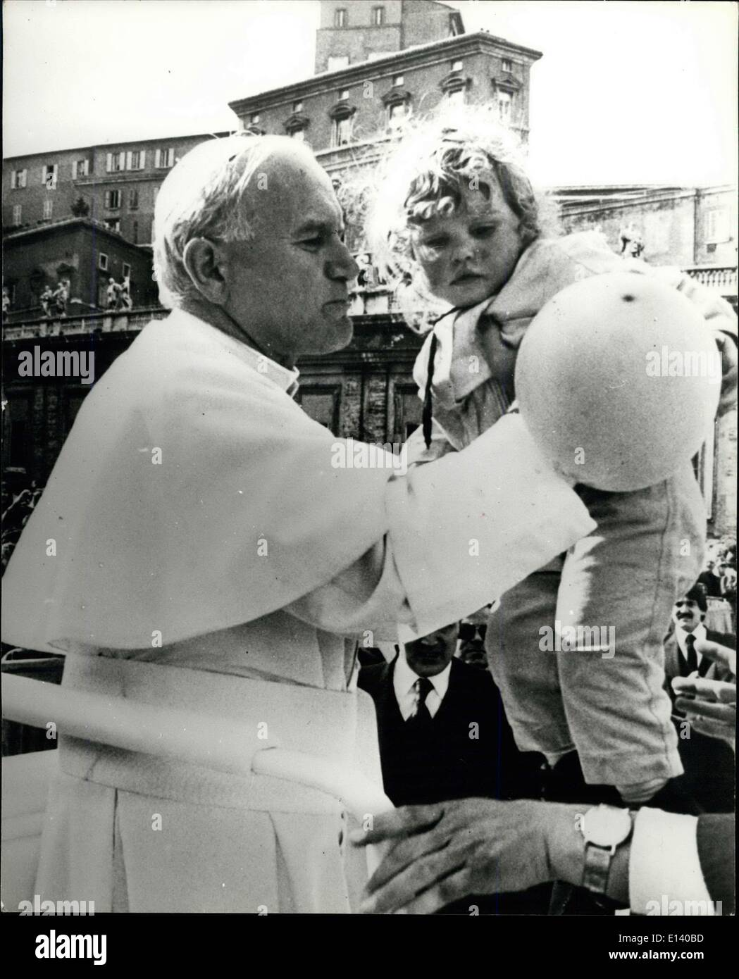 Mar. 31, 2012 - Porp John Paul II shot in St Peter's Square: Pope John Paul II, seen as he lift's a little girl Stock Photo
