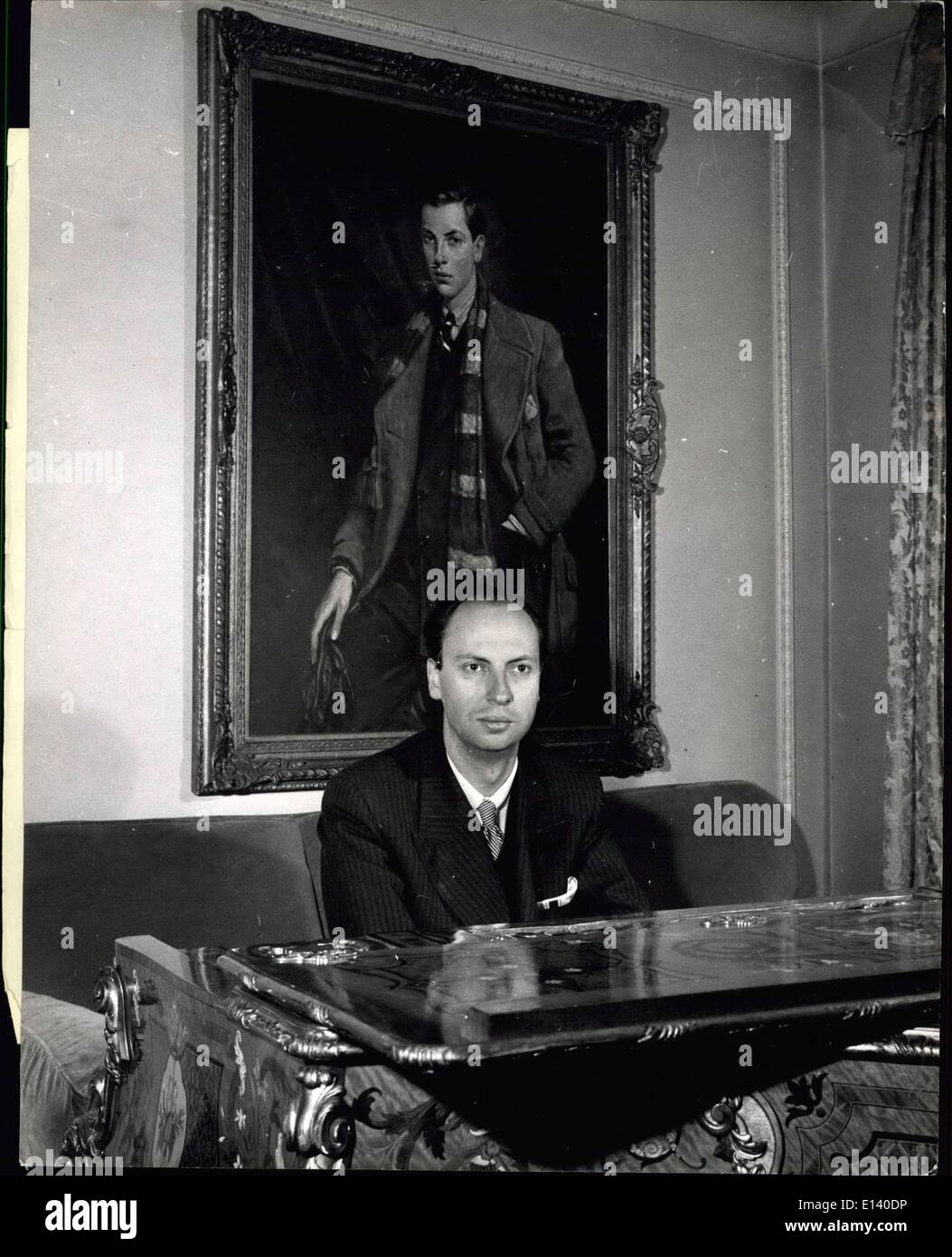 Mar. 31, 2012 - The professional pianist of the Perrage: Lord Foley at his £10,000 mother-of-pearl inlaid crested ancestral grand piano. Behind him is a painting of himself as a boy by Arthur Pan. It was one 1940. - Stock Image