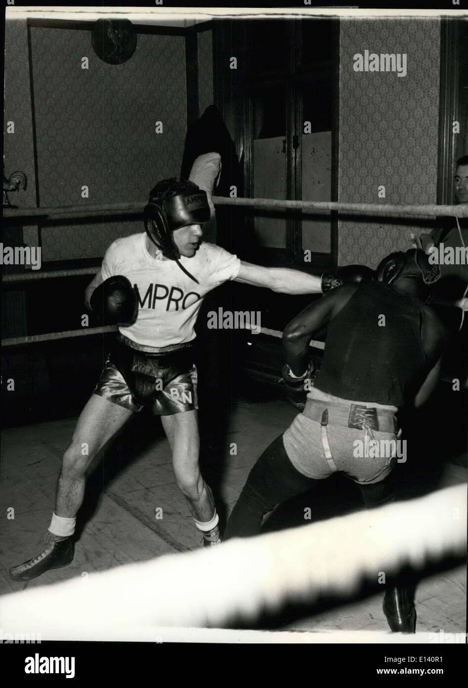 Mar. 31, 2012 - Bobby Practices with His Left. Bobb Neill hits out sparring partner Edward O'Dell in the ring of the gym - Stock Image