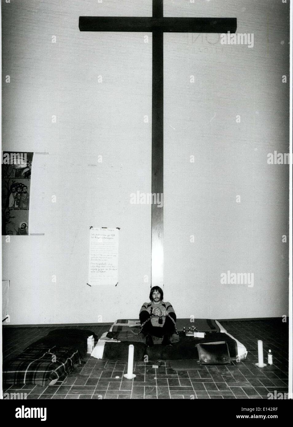 Apr. 04, 2012 - Young Conscientious Objector Chained Himself At The Crucifix Of The St. Johannis-church: ''I'm a Stock Photo