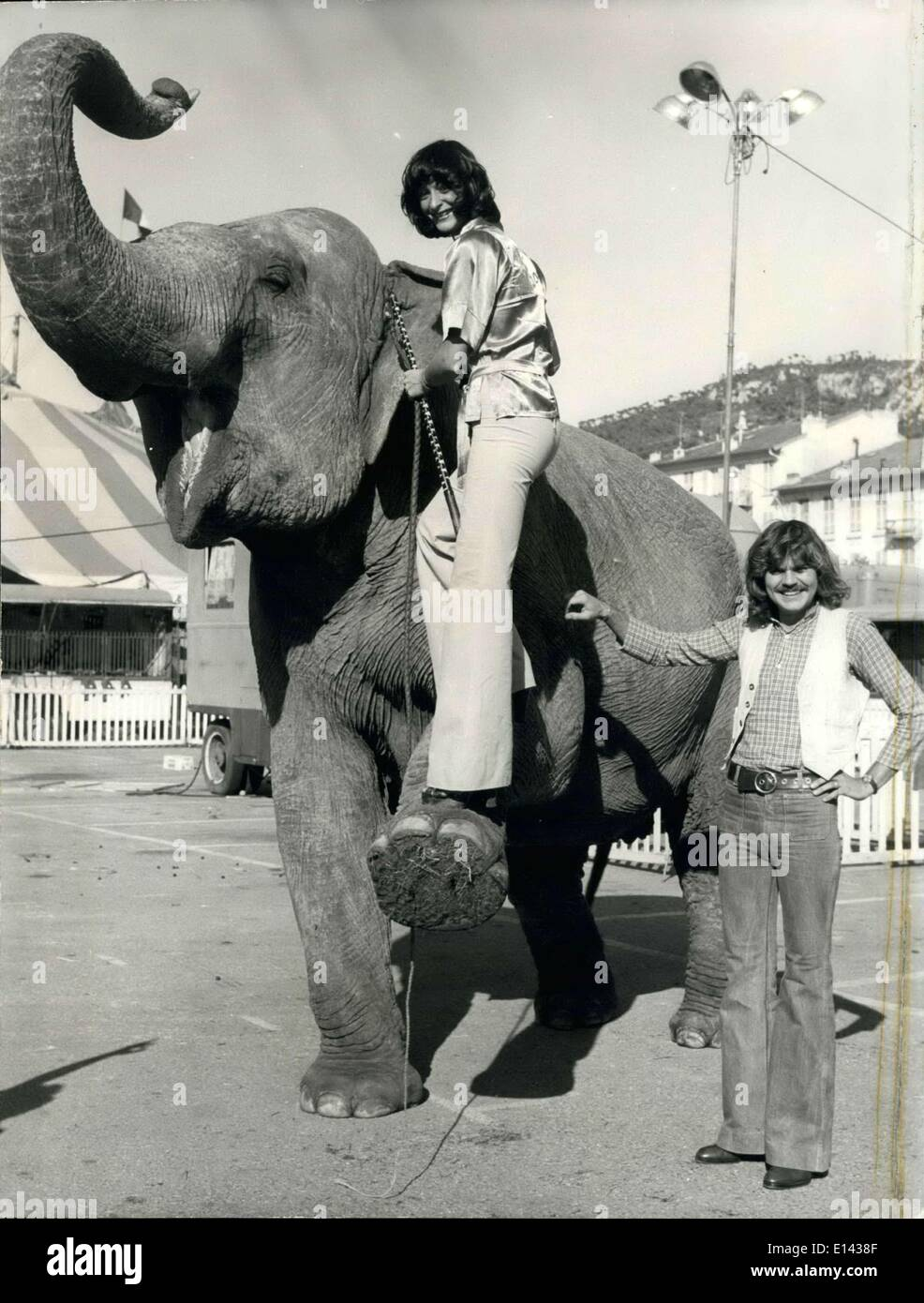 Mar. 31, 2012 - French vocalist team of Catherine Duquesne and Henry Evieux, The Mandarins befriend an old friend at the Jean Richard Circus in Nice. Duquesne was a former acrobat and dancer with the circus but had a specially soft spot for the elephants. - Stock Image