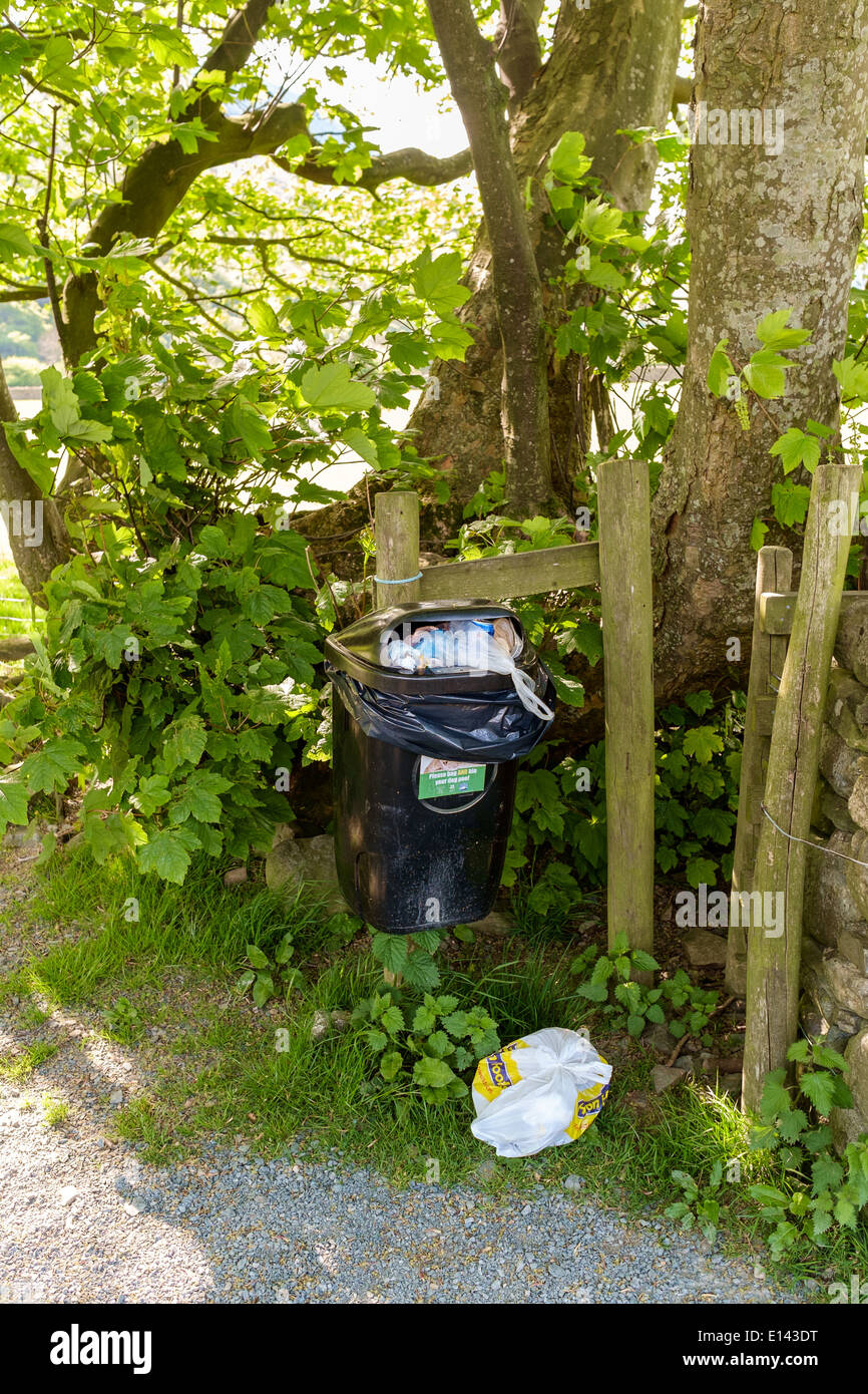 Overflowing rubbish bin in beautiful Lake District, Buttermere, countryside. - Stock Image