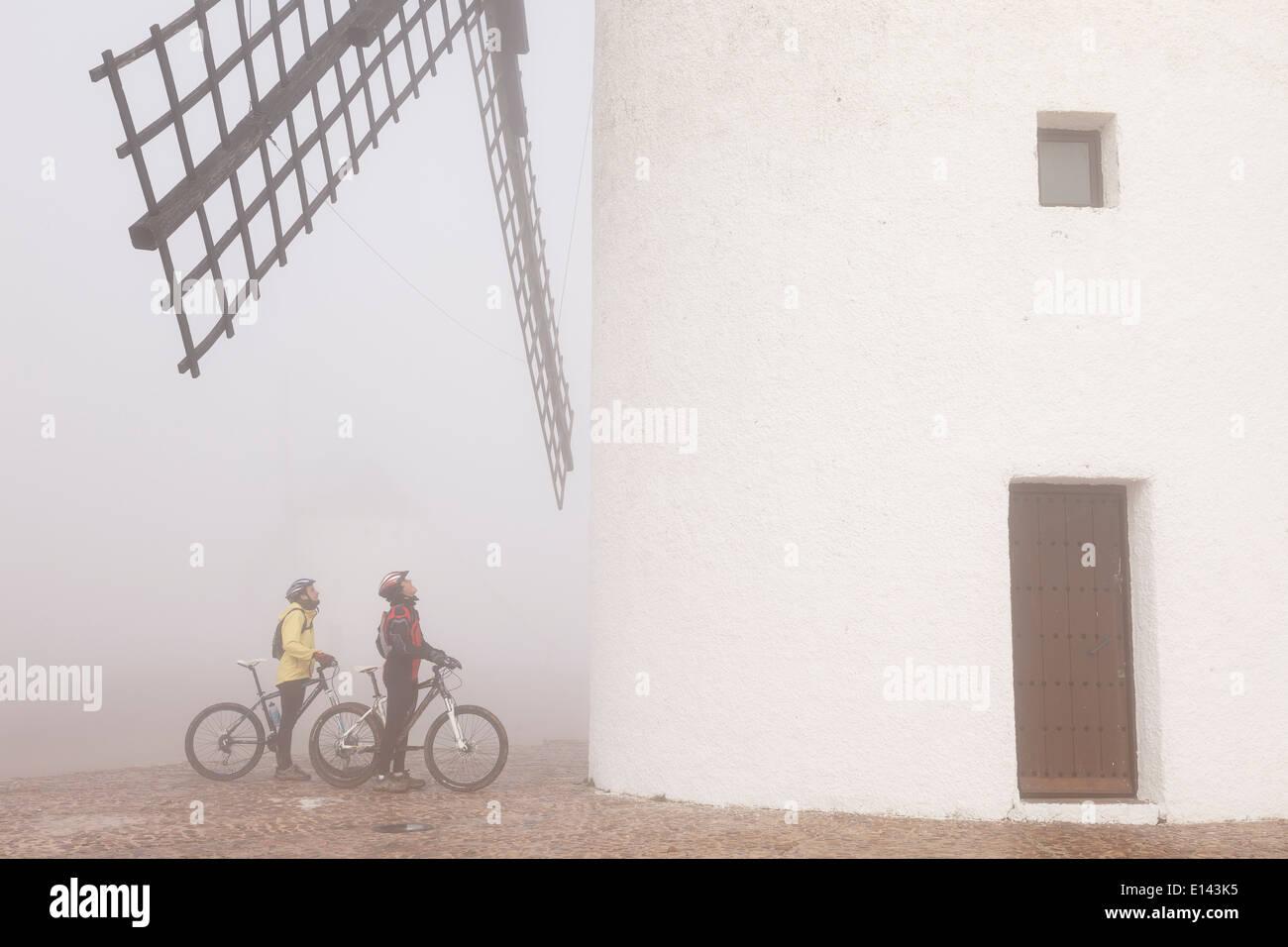 MIlls and bikers. Alcazar de San Juan. Ciudad Real. La Mancha. Spain. Europe - Stock Image
