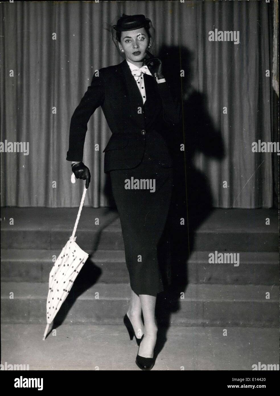 Apr. 04, 2012 - Paris Fashion: Spring 1953: ''Dandy'', Navy blue tailored suit. Designed by Maggy Rouff. to - Stock Image
