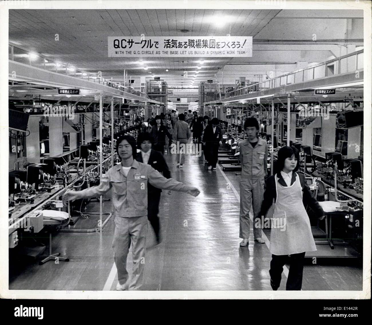 Apr. 04, 2012 - Matshushita Panasonic color T.V. production Osaka, Japan: He Japanese lead the world in production of color television sets. Here at Matsushita Ibiraki factory in Osaka Japan aremate color television sets under the brand name of Panasonic. Most of the sets are for export. Photo shows workers on the production line taking a ten minuted exercise break. - Stock Image