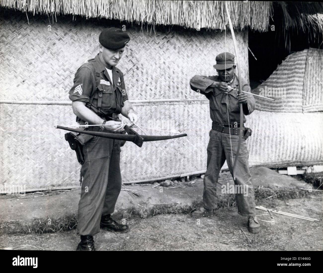 Apr. 04, 2012 - Vietnam, Primitive Weapons An American and Vietnam Soldier try out a cross- bow and a long bow which are made by the village defenders. - Stock Image