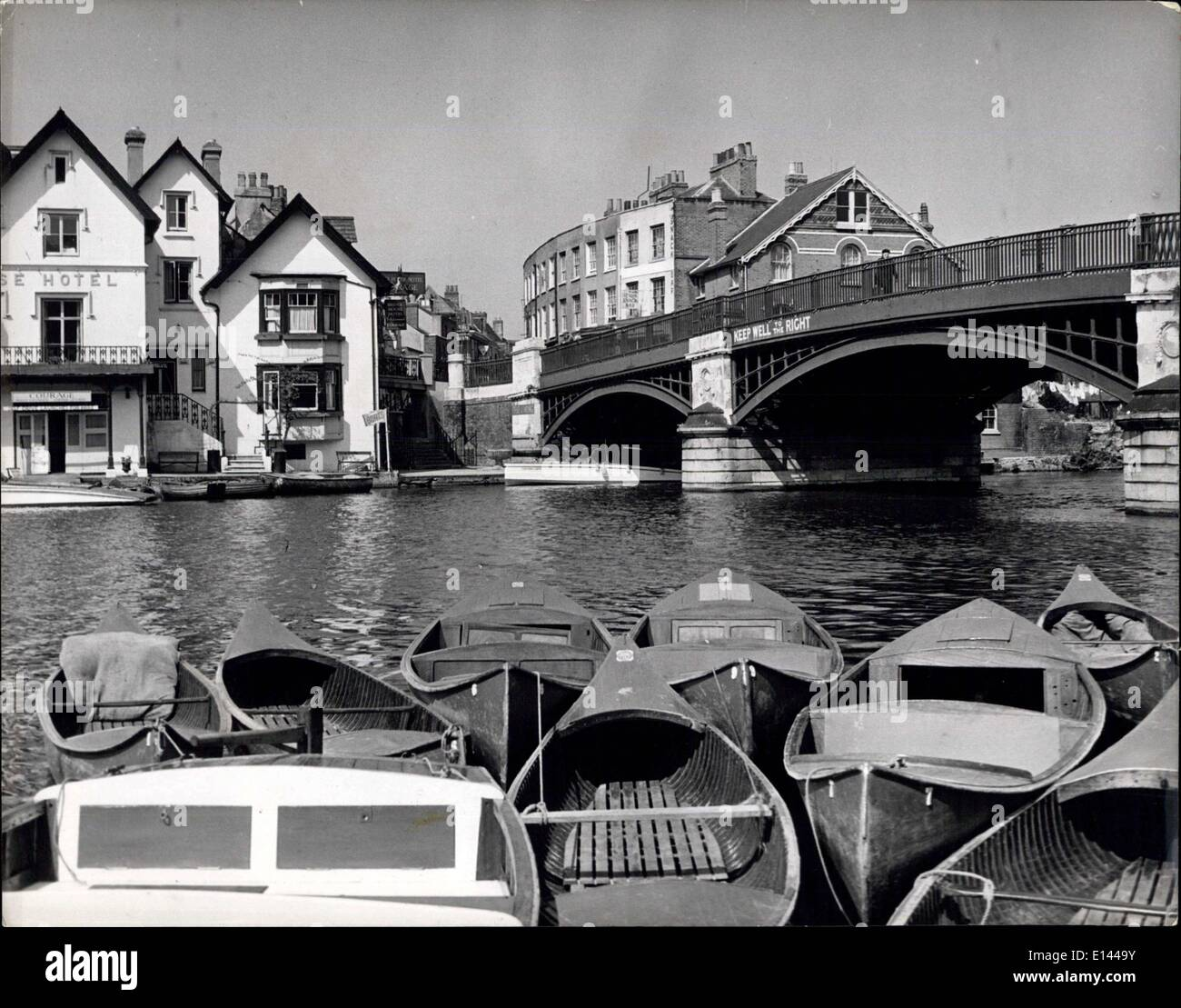 Apr. 04, 2012 - Windsor Bridge spanning the Thames and looking towards Eton, with punts and small boats in the foreground ready - Stock Image
