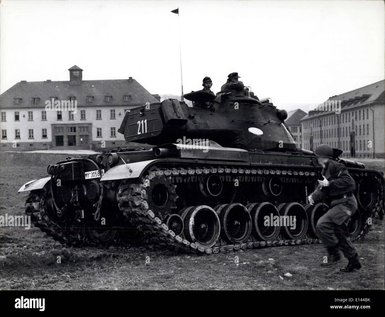 Apr. 04, 2012 - Close-combat of tanks with hand grenades and concentric charges is a very dangerous matter in war. Here each part of the attack is being practiced a thousand times. The training tank is the American M47. - Stock Image