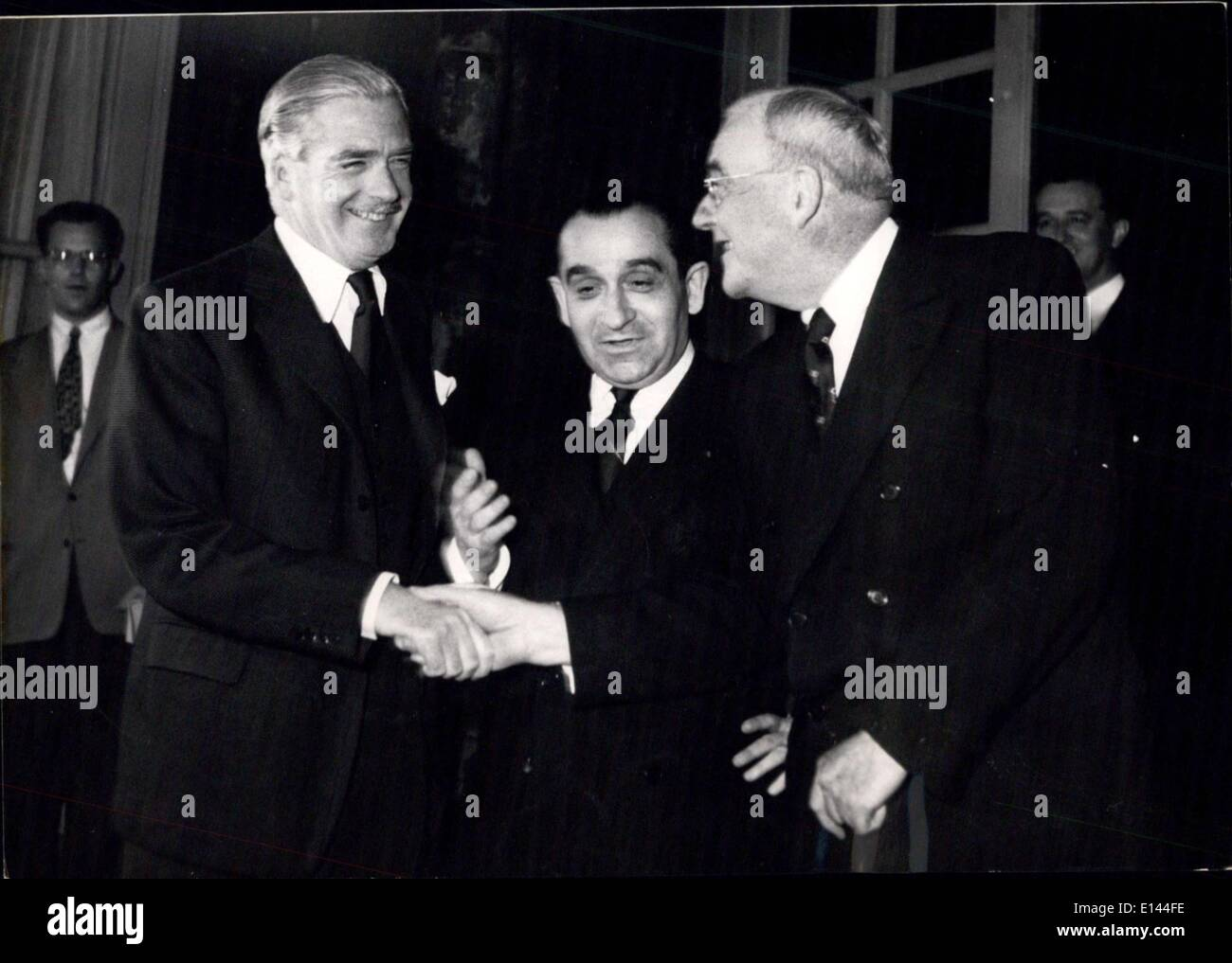 Apr. 04, 2012 - Mendes France Rushes back form Geneva to meet Dulies and Anthony Eden: M. Mendes Frabce photographed with Mr. Foster Dulies and Mr. Anthony Eden in Paris tonight. - Stock Image