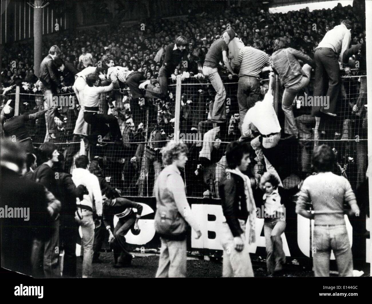 Apr. 04, 2012 - Manchester United Barred From Europe: Owing to the violent rioting by the Manchester United supporters in the match between Manchester United and St. Etienne they have been suspended by Union of European Football Association. Photo Shows: Rioting fans climb over the barriers during the match in France. - Stock Image