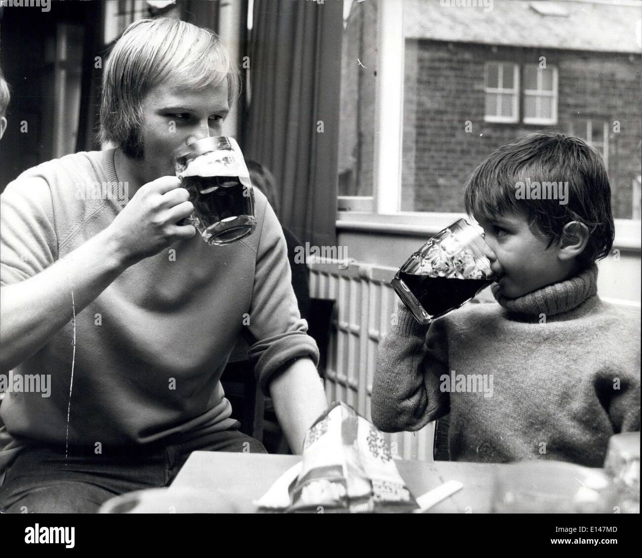 Apr. 17, 2012 - Six-year-old Andrew Born sinks a pint with Peter Fitton after training. ''Mine's Coke'' says Andrew. - Stock Image
