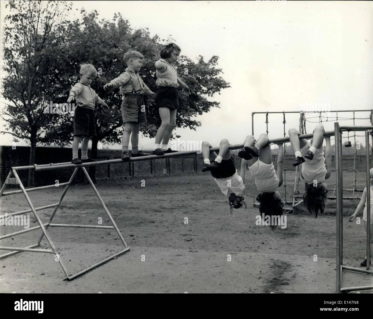 Apr. 17, 2012 - The Balance and the Swing: Some children prefer to teach themselves to 'tight rope' across - Stock Image