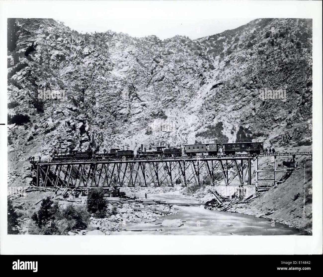Apr. 17, 2012 - Birthday of a Memorable Achievement: Contennial of transcontinental railroad link-up in U.S. Identifying caption: 1869 construction of the Union pacific section of the transcontinental railway across Devil's Gate Bridge, Utah. - Stock Image