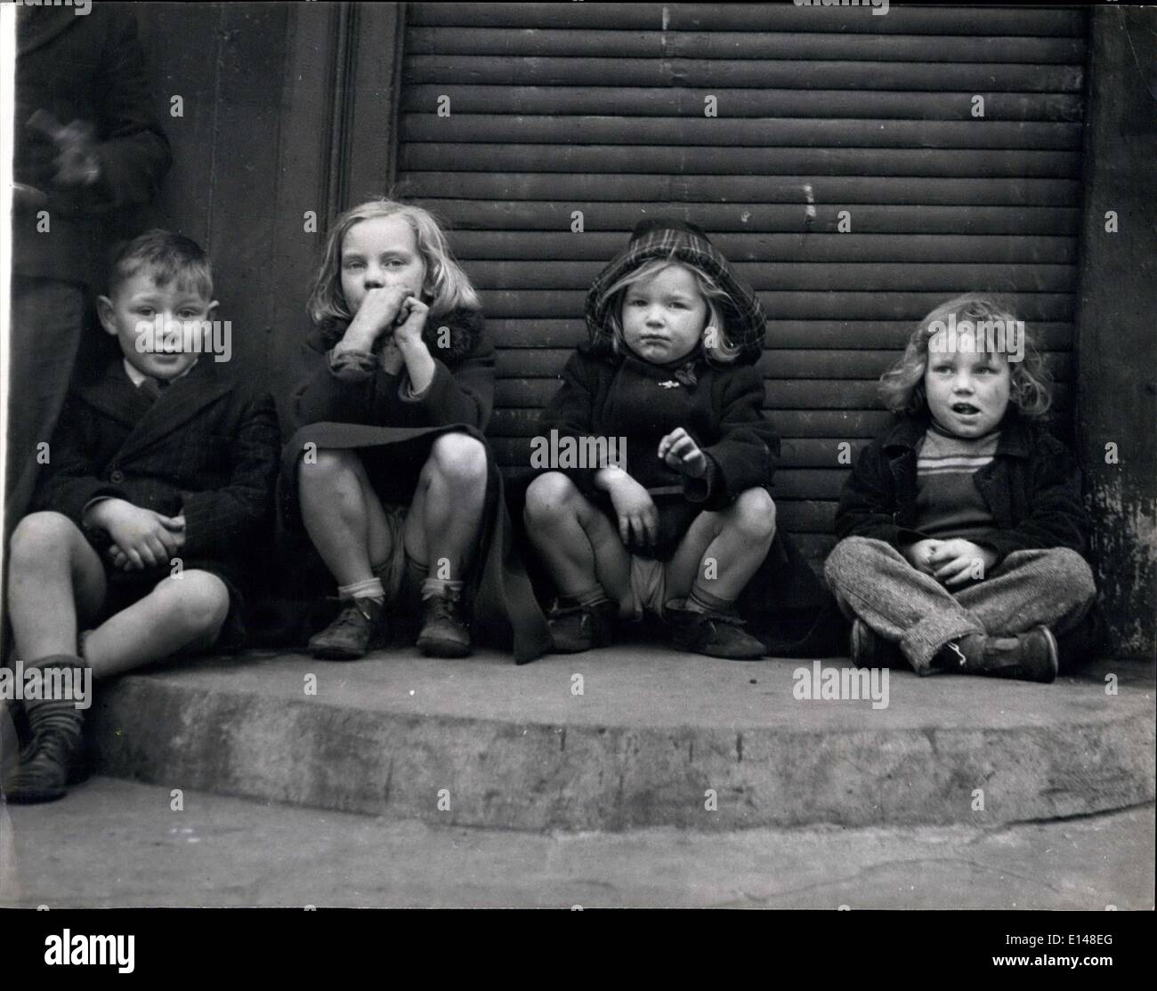 Apr. 17, 2012 - Nothing To Do. Nowhere To Go: In the crowded streets of London very few houses have gardens for the children to - Stock Image