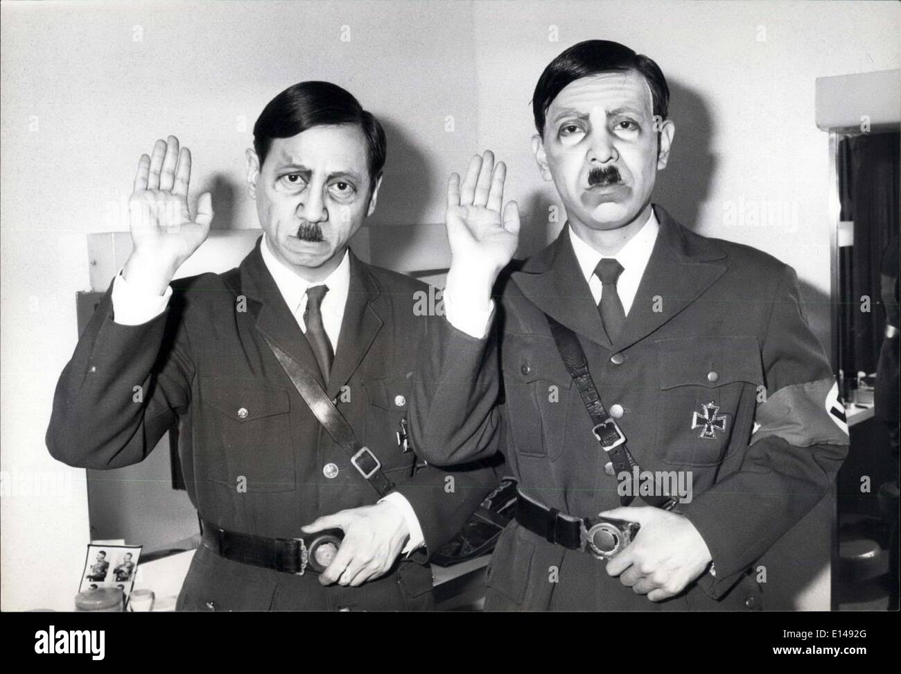 Apr. 17, 2012 - Hitler - two of them in Tokyo: ''Hitler did not die-yet'' is the title of a play by Japanese author Tsuneari Fukuda, being performed at the Asahi Seimei Hall in Shinjuku, Tokyo by the Shiki Theatrical group. In the play, two Hitler's appear each claiming ''I am the real Hitler, the other is my substitute''. Finally it is revealed that they are both substitutes for Hitler. The point Fukuda tries to make in the new play, is to show that hero worship by the people remains, whether the hero is real or not, and all they want is a hero of some kind - Stock Image
