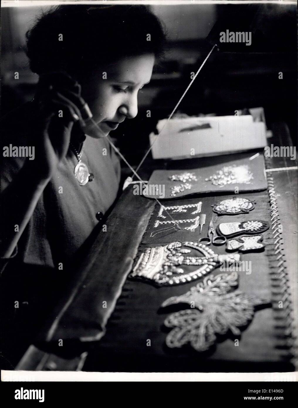Apr. 17, 2012 - Embroidering the crown and the E.R. Cipher which a does the well known scarlet tunics of the Yeomen Stock Photo