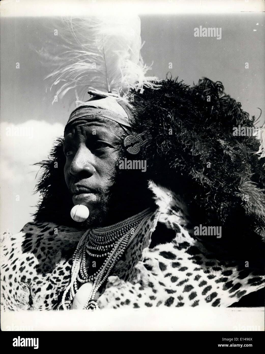 Apr. 17, 2012 - Royal Garden Party At Government House Nairobi: Chief Pel Pel of the Turkana made an impressive figure at the Royal Garden Party. He wears an elaborats headdress of feathers and beads. A leopard skin cape and a billiard ball on his chin. - Stock Image