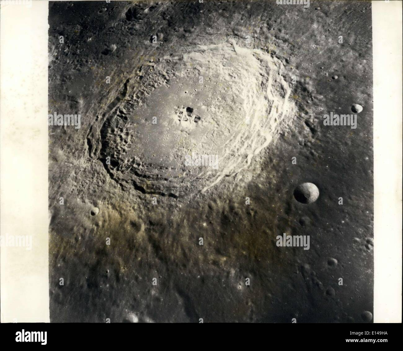 Apr. 17, 2012 - Apollo 8 Moon view: The crater Langrenus as photographed from an altitude of nearly 150 nautical miles as the Apollo 8 spacecraft orbited the moon on December 24th, 1968. Langrenus is about 85 statute miles in diameter. Command Moduel Pilot James A. Lovell described the crater, its central peak, and the conspicuous terrace on the inner crater wall shortly after acquiring earth communications for the first time after lunar orbit insertion. At the time the photograph was made, Langrenus was about 100 nautical miles (190 kilometres) south of the spacecraft ground track - Stock Image